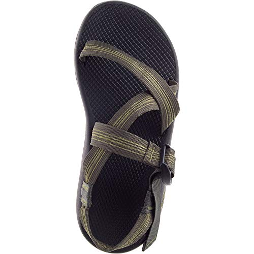 Chaco Men's Z1 Classic Sport Sandal, Bluff Hunter Polyester jacquard webbing upper wraps around the foot and through the midsole for a customized fit adjustable and durable high-tensile webbing heel risers injection-molded ladder lock buckle Luvseat PU midsole vegan-friendly construction Non-marking ChacoGrip rubber compound 3.5mm lug depth Streamlined and dependable since 1989, Our classic series is comprised of only 8 component parts, making for the simple, timeless sandal design that made our name. Every pair comes standard with adjustable straps that custom-fits to your foot, Plus our podiatrist-certified LUVSEAT PU footbed for all-day comfort and support. Now featuring chacogrip rubber for our best performing classic outsole to date. Experience our classic sandal like never before.