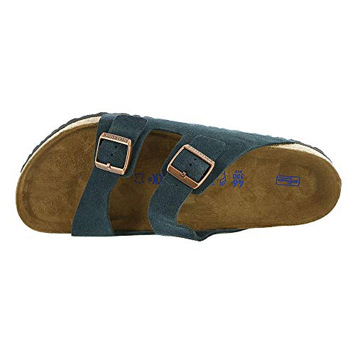 Birkenstock Arizona Soft Footbed Dark Navy Suede Sandals Skin-friendly and hardwearing signature Birko-Flor upper Soft fleece lining on the underside of the upper Anatomically correct, suede lined, natural cork-latex footbed Raised toe bar, neutral heel profile and deep heel cup Flexible and lightweight EVA outsole, Regular fitting The often imitated, never duplicated, category-defining, two-strap wonder from Birkenstock. A comfort legend and a fashion staple.